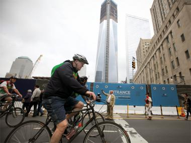 Riders from the Five Boro Bike Tour pass the World Trade Center on May 6, 2012.