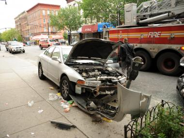 A car collided with a vehicle on Franklin Avenue in Crown Heights on Mon., May 7, 2012, before hopping a curb and crashing into a parking meter.