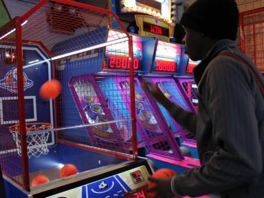 Patrice Laud, a Bronx resident, tried his luck at a basketball game at the Chinatown Fair arcade.