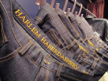 Guy Wood, owner of 5001 Flavors, a custom design line, has opened Harlem Haberdashery on Lenox Avenue. Pictured are jeans from Wood's line.