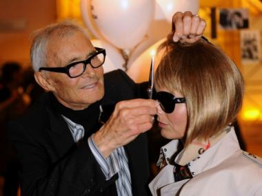 Vidal Sassoon attends his Vidal Sasautobiography signing with an Anna Wintour lookalike at Selfridges department store in London  on Sept. 8, 2010.