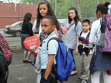 Students rallied against cuts to after-school programs at Sol Lain Park in the Lower East Side on May 9, 2012.