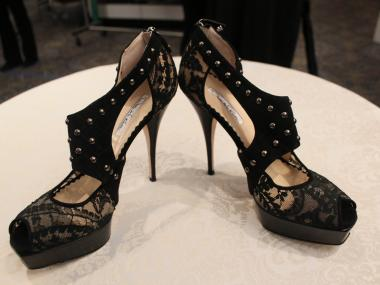 Oscar de la Renta black lace heels with stud detail are $475 at the POSH sale. They  were bought for about $1,300.