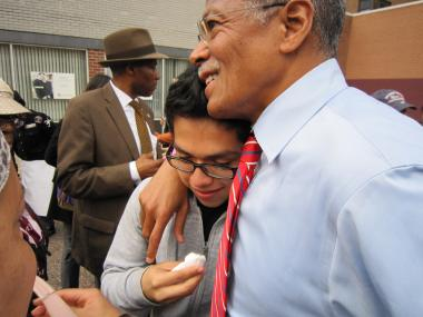 Elevit Perez, 17, teared up and was comforted by Councilman Robert Jackson after telling people how he was beaten and terrorized by a gang.