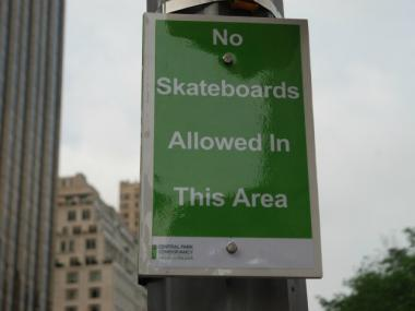 Skateboarding is prohibited in the circle, but few even notice the signs.
