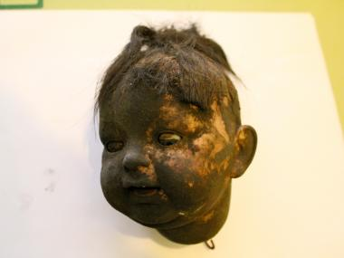 A doll's head with hair, teeth and eyes that move rolled out as museum workers gradually opened up a fireplace, according to Kathleen O'Hara. She predict it is made from bisque or some sort of ceramic material.