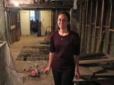 Kathleen O'Hara inside the basement of 97 Orchard St., where artifacts were uncovered from two fireplaces.