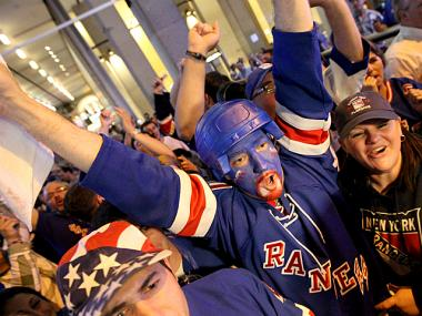 New York Rangers fans celebrate after the 'blueshirts' defeated the Washington Capitals to reach the Eastern Conference finals.