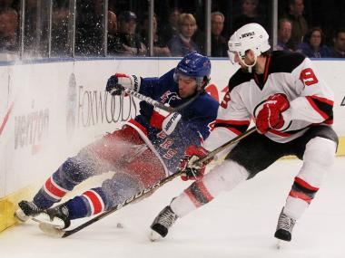 The Rangers' Michael Del Zotto and the Devils' Travis Zajac fight for the puck during New York's 3-0 win over the New Jersey in the Eastern Conference Championship on Mon., May 14, 2012.