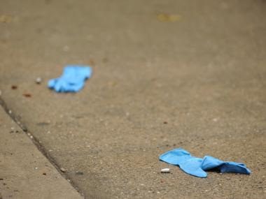Blue surgical gloves were used to mark the location of evidence at a crime scene Wednesday May 16th, 2012.