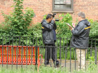 NYPD Crime Scene Investigators take photos at a crime scene outside in Brooklyn on May 16th, 2012.