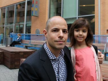 Jemuel Ripley and his daughter, who is in kindergarten at the Spruce Street School. Ripley wants the city to install speed bumps near the school.