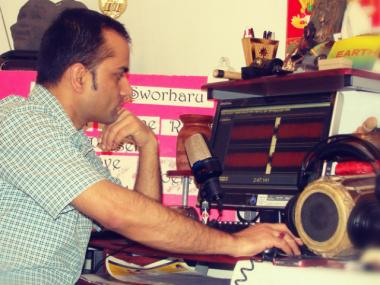 Poudel produces his bare-bones podcast from his Ridgewood, Queens home