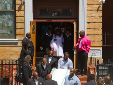 Doris Chase, the mother of Yakim McDaniels, the 12-year-old boy who was crushed to death Sunday, May 6, by a rolldown gate in his building's parking lot at 230 Lott Ave. in Brownsville, Brooklyn, follows her son's casket at his funeral Thursday, May 17, in Bedford-Stuyvesant, Brooklyn.