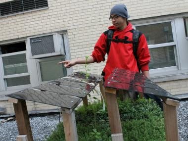 Bronx Design and Construction Academy student Noel Cruz shows off a model green roof and solar panel canopy that they used in a study. Cruz and another student, Elton Hollingsworth, presented findings from that study at an international conference in Denver on Wednesday.