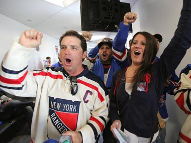 Rangers fans board Delta's Fan Flight to Newark, New Jersey for Game 3 of the Stanley Cup playoffs on May 19, 2012.