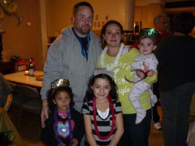 Harlan Gray, his wife Liz, and their three daughters. May 21, 2012.