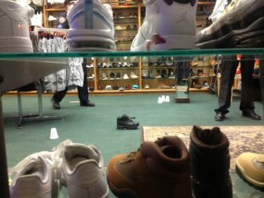 Cups mark bullets and casings in the Rugged Sole shoe store at 298 Utica Ave. May 21, 2012.