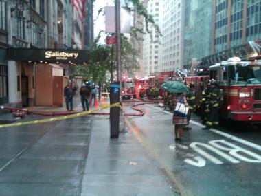 A blaze broke out in the basement of 123 W. 57th Street Tuesday morning, forcing evacuations, FDNY officials said.