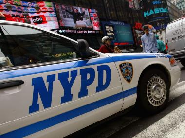 A police officer was hit by a car in Times Square on Tuesday, Dec. 11, 2012. The vehicle then fled the scene, police said.
