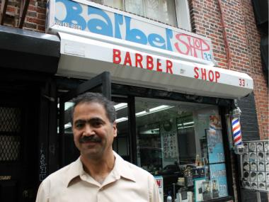 Leo Ilyayev, manager of Ilya's Barber Shop on Lispenard Street, wants the city to install more street signs.