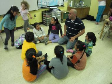 "Mohamed Mamdouh, a teacher for the Global Language Project, played a game of ""Duck Duck Goose"" with kids at P.S. 368 in Harlem to help teach them Arabic."