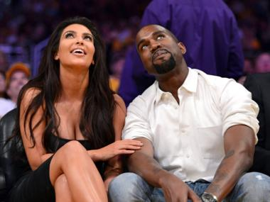 Kim Kardashian and Kanye West watch the video board from their courtside seats as the Los Angeles Lakers take on the Denver Nuggets in Game Seven of the Western Conference Quarterfinals in the 2012 NBA Playoffs May 12, 2012 in Los Angeles.