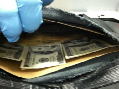 Customs officials seized almost $200,000 in fake notes hidden in kids' books and folders in two separate seizures in May.