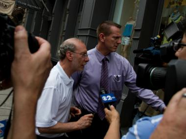 Stanley Patz, left, father of Etan Patz, did not speak to reporters as he arrived home May 25, 2012, the 33rd anniversary of his son's disappearance.