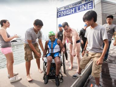 MInda Dentler, 34, from New York, a disabled athlete completes the 2012 Great Hudson River Swim.