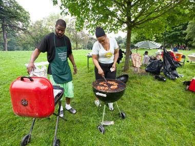 A couple BBQ and enjoy Memorial Day weekend in Prospect Park, Brooklyn on May 27th, 2012.