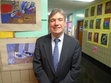 "Principal Bob O'Brien with artwork by P.S. 75 students. O'Brien calls the arts a ""cornerstone"" of education."