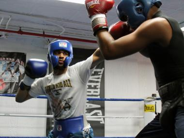 Sadam Ali, left, spars at his gym Friday.