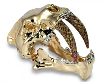 """libidine,"" a golden sabertooth lion skull by artist Michael Johnson, will be on display at ArtNowNY."