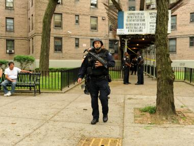 ESU Officers leave 40-11 Vernon Boulevard in Queens after searching for a suspect on Wednesday May 30th, 2012.