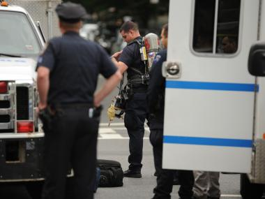 Officers at the scene of a suspicious package at 174 Scholes Street in Brooklyn on Wednesday May 30th, 2012. The package turned out to be a toy.