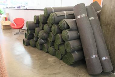 About 30 rolls of AstroTurf are being stored at the LES BID in preparation for Sunday's Daylife event.