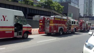 Fire trucks line Tenth Avenue at 15th Street Friday.
