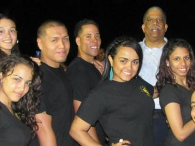 Council Member Leroy Comrie poses with dance instructors from Lorenz Latin Dance Studios, who were at last year's event