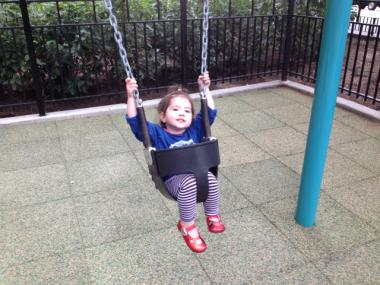 20-month-old Lucy enjoyed the swings in the new Pearl Street Playground on June 1, 2012.
