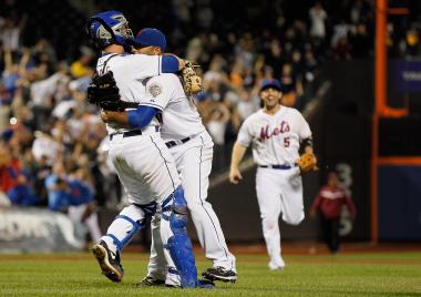 Johan Santana #57 of the New York Mets celebrates with Josh Thole #30 and David Wright #5 after pitching a no hitter against the St. Louis Cardinals at CitiField on June 1, 2012.