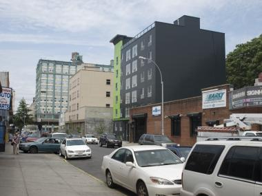 The hotel stands out from its surroundings, which include an auto-parts garage, a flophouse and the Gowanus Expressway.
