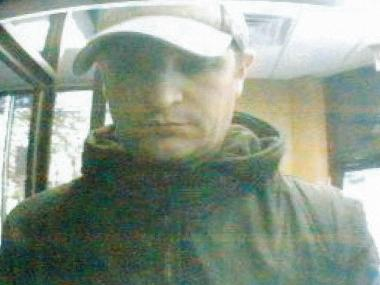 Police are searching for a man who allegedly used a fake ATM card to steal cash from an ATM in Woodhaven on April 29, 2012.