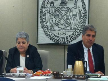 Council Members Maria del Carmen Arroyo and Domenic Recchia noshed on some chips at a Health Department hearing June 4, 2012.