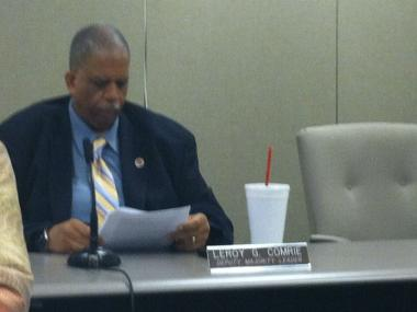 Councilman Leroy Comrie enjoys the 32-ounce drink of his choice during the Health Board Budget hearings on June 4, 2012.