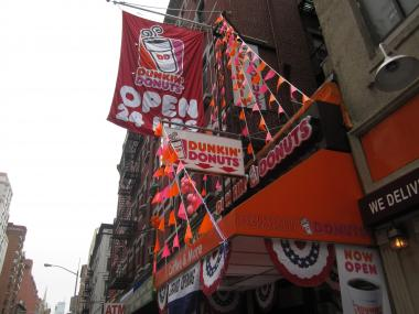 The Department of Buildings said it is looking into whether a new Lexington Avenue Dunkin' Donuts is in compliance with signage laws.