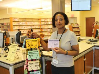 Tienya Smith, manager of the Long Island City public library, says many families rely on branch services daily.
