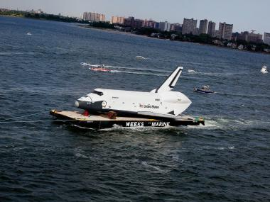 The shuttle Enterprise floats through New York Harbor on June 3.