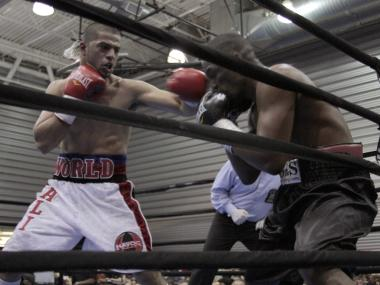 Sadam Ali hammers Franklin Gonzalez on Saturday night at the Aviator Sports Complex in Brooklyn.
