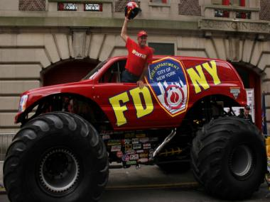 10-time Monster Truck world champion Tom Meents poses with the FDNY's latest toy.